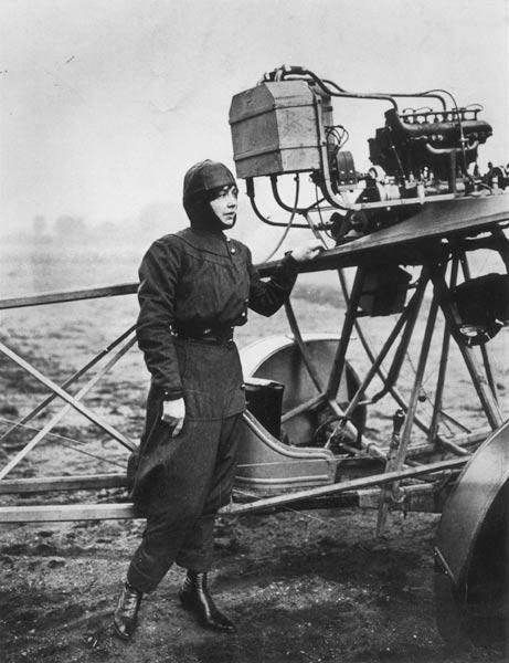Helene Dutrieu (1877-1961) standing beside a plane, before 1914 (b/w photo)