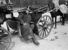 Berl.Coachman Sleeping on his Cab /Photo