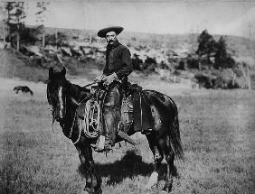 Cowboy riding a horse in Montana, USA, c. 1880 (b/w photo)