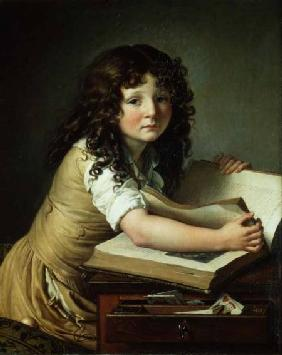 A child looking at pictures in a book