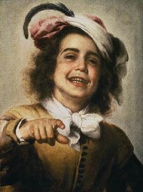Laughing boy with a feather adorned headdress.