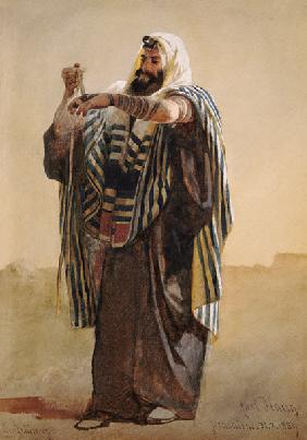 A Jerusalemite Shepherd Winding the Phylacteries for the Hand