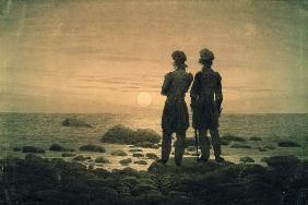 Two men at moonrise by the sea