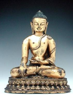 A Chinese gilt bronze figure of the Buddha in meditation