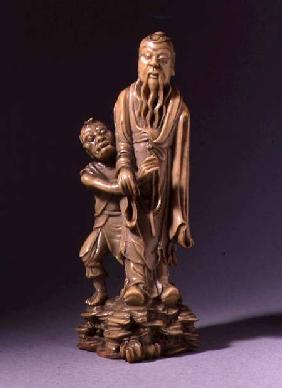 Figure of Zhong Kui, supported by a demon servant, Qing dynasty