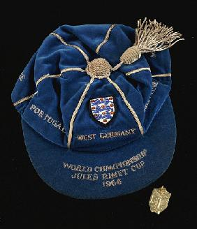 A Continental Gold World Cup Winner''s Medal And A Blue England World Cup 1966 International Cap Awa