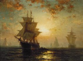 Sailing ships at sunset