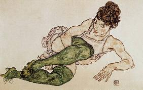 Reclining woman, green tights