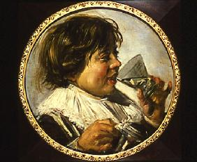 Half-length portrait of a laughing boy with a wine-glass