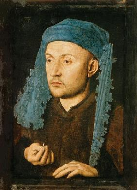 Portrait of a man with a blue headgear
