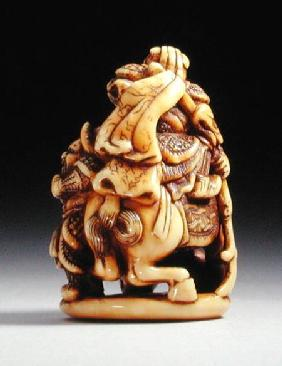 Reverse side of a netsuke in the form of a Chinese warrior on horseback with his attendant