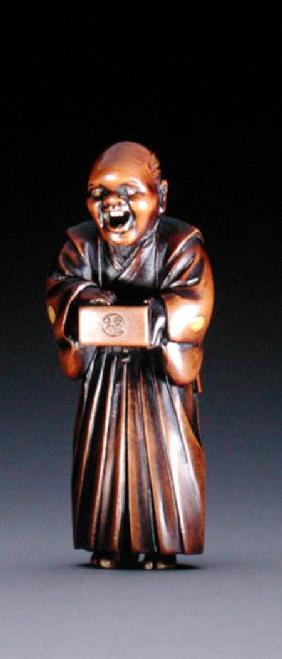 Netsuke depicting a standing priest