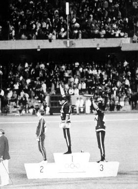 1968 Olympic Games. Mexiko City. Mens 200 m. TOMMIE SMITH, USA, Gold, and J. CARLOS, Bronze, in Blac