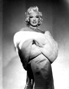American Actress Mae West with fur stole