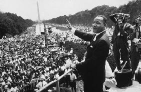 Martin Luther King American priest activist for Civil Right Movement of black Americans saluting the
