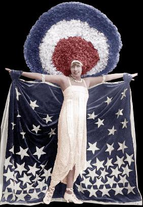 Mistinguett wearing giant headgear in her show in Paris