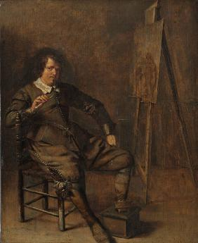 Portrait of a painter in front of his easel