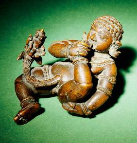 A South Indian Bronze Figure Of Vatapattrasayin, Vishnu In His Incarnation As Krishna, Depicted As A