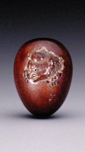 Netsuke depicting a crow emerging from its egg